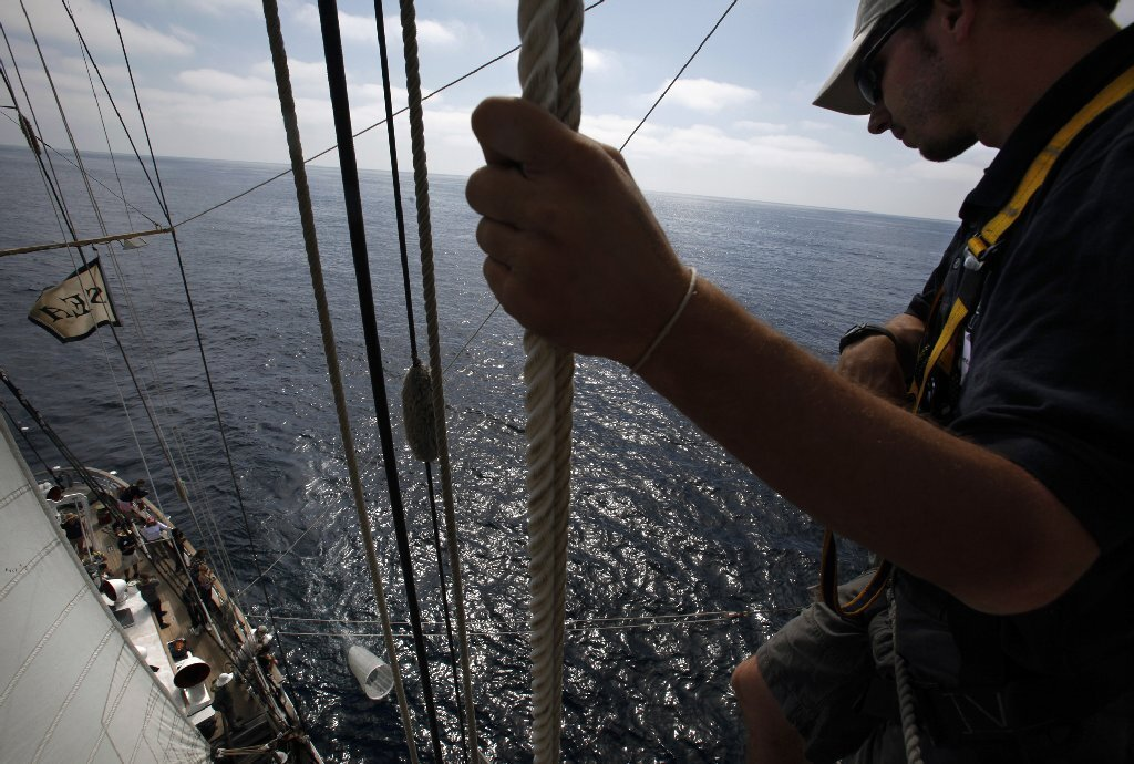 Max McClorey, a crew member aboard the Sea Education Assn.'s brigantine Robert C. Seamans, watches as a net is deployed to collect marine specimens that will be studied in labs at the University of San Diego.