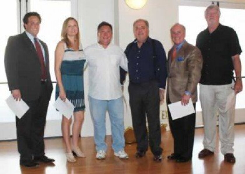 La Jolla Village Merchants Association's newly elected board members are La Jolla Blue Book President Scott Levin; La Jolla Cove Suites' General Manager Krista Baroudi; Leon Chow of C&H Photo; current board president Phil Coller of Everett Stunz; certified public accountant and attorney Mark Kr