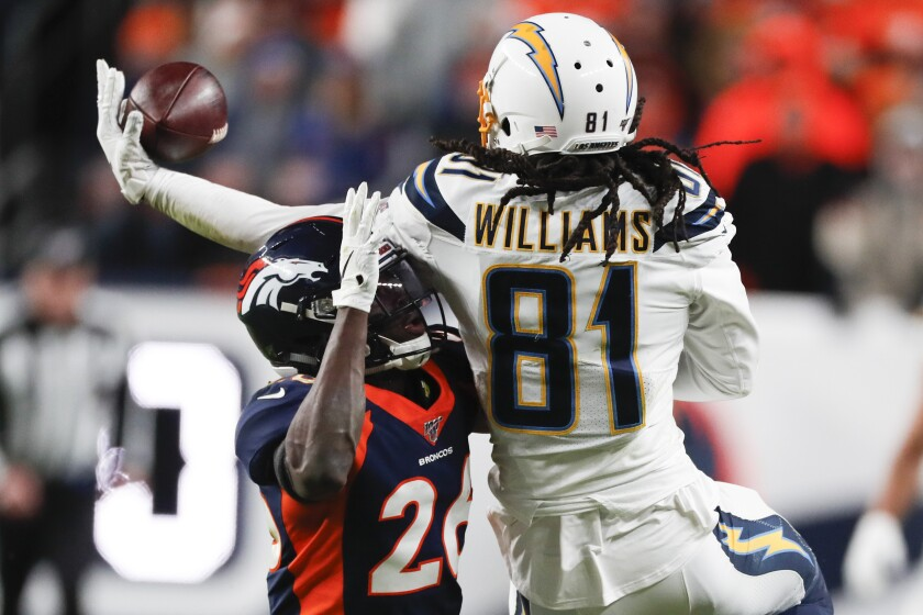 Chargers receiver Mike Williams made some incredible catches against the Broncos, including this one next to cornerback Isaac Yiadom.