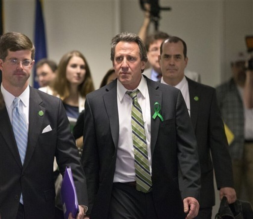 Neil Heslin, center, whose 6-year-old son Jesse was killed in the mass shooting in Newtown, Conn., arrives with other victims' families to meet privately on Capitol Hill in Washington, Tuesday, April 9, 2013, with Sen. Richard Blumenthal, D-Conn., and Sen. Chris Murphy, D-Conn. Heslin gave moving testimony during a Senate Judiciary Committee hearing in February on the proposed assault weapons ban. (AP Photo/J. Scott Applewhite)