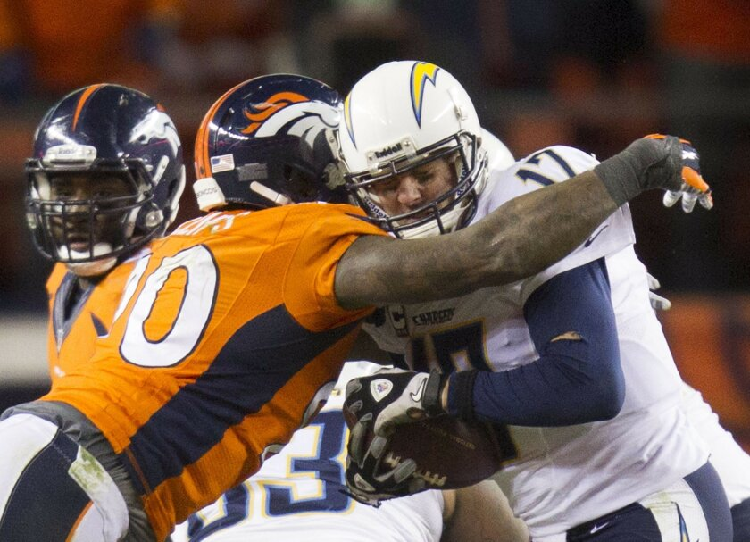 San Diego Chargers vs. The Denver Broncos at Sports Authority Field.  Philip Rivers sacked by Shaun Philips in the 4th quarter.