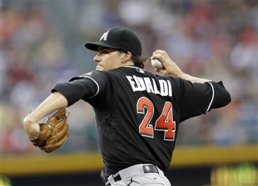 Miami Marlins starting pitcher Nate Eovaldi (24) works in the first inning of a baseball game against the Atlanta Braves in Atlanta, Saturday, Aug. 10, 2013. (AP Photo/John Bazemore)