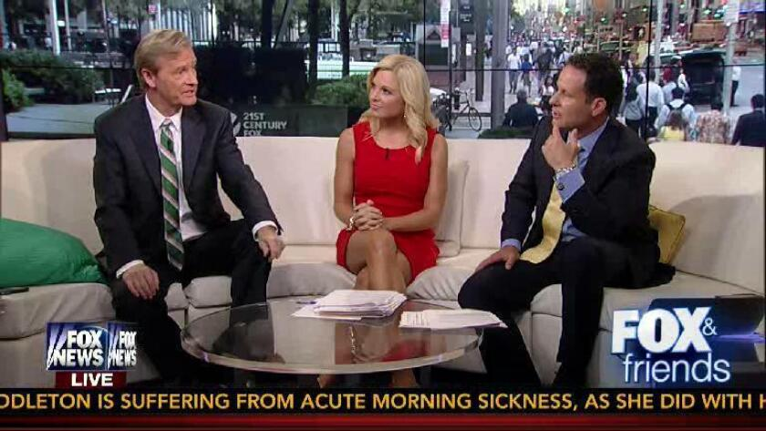 "From left, ""Fox & Friends"" host Steve Doocy, fill-in host Anna Kooiman and host Brian Kilmeade on air."