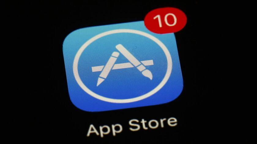FILE - This March 19, 2018, file photo shows Apple's App Store app in Baltimore. As its iPhone sales