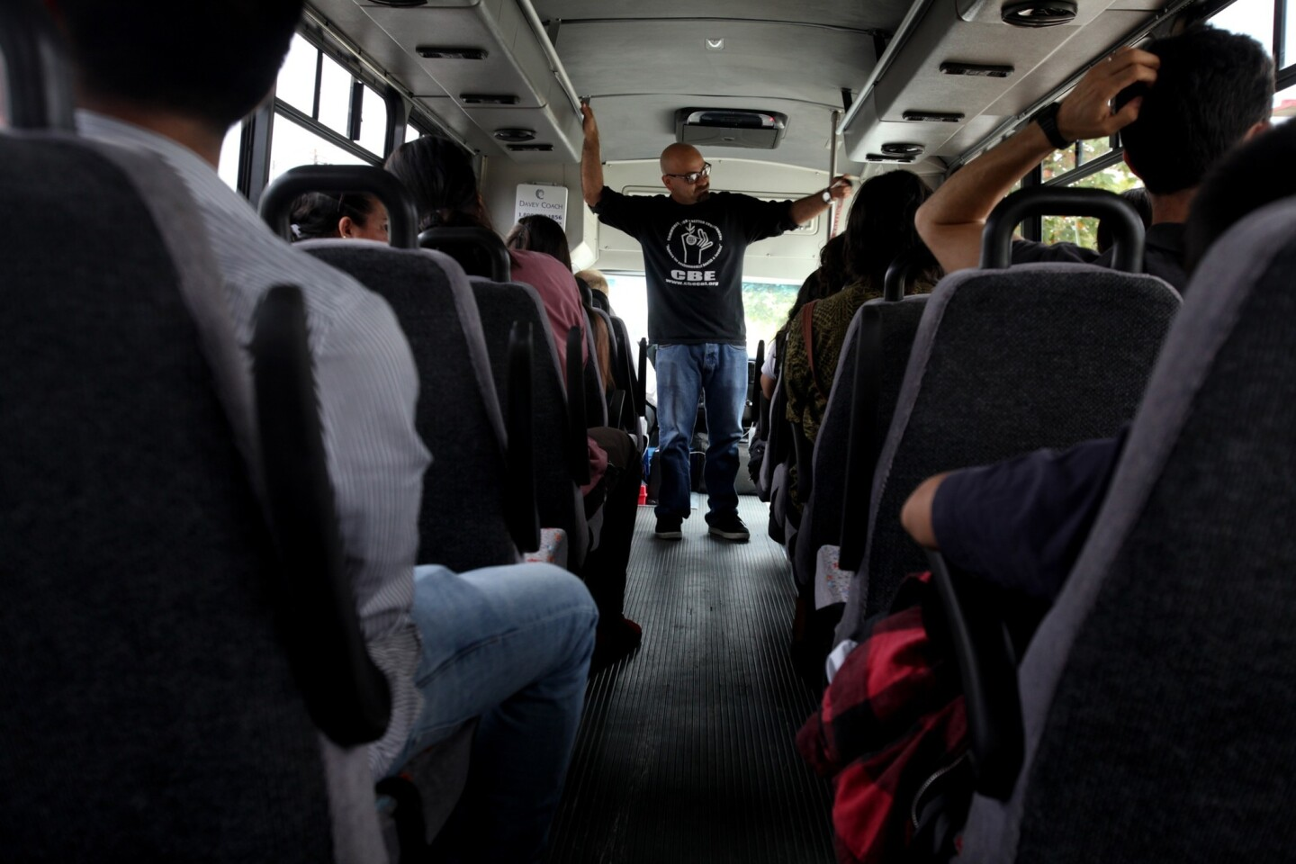 "Roberto Cabrales, an organizer with Communities for a Better Environment, briefs sightseers on a ""toxic tour"" starting in Huntington Park. The half-day excursions were begun in 1994 as a way to show government officials the consequences of their decisions on low-income and predominantly Latino communities."