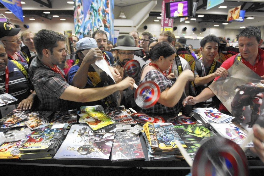 Comic-Con International, seen at the San Diego Convention Center in 2011, will stay through at least 2018 in the seaside SoCal city where it started in 1970.