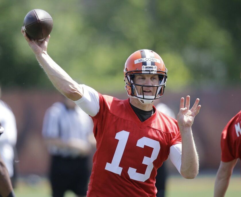 FILE- In this June 2, 2015, file photo, Cleveland Browns quarterback Josh McCown throws during an NFL football organized team activity in Berea, Ohio. Browns coach Mike Pettine said Monday, July 27, 2015 that veteran McCown will open training camp as the team's No. 1 quarterback, (AP Photo/Tony Dejak, File)