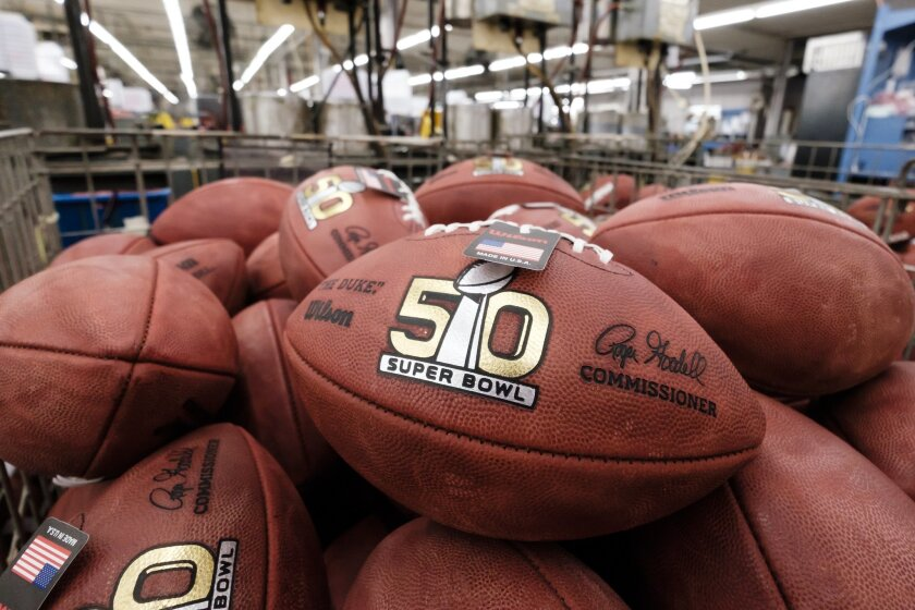 Official balls for the NFL Super Bowl 50 football game are seen in a bin prior to final inspection at the Wilson Sporting Goods Co.
