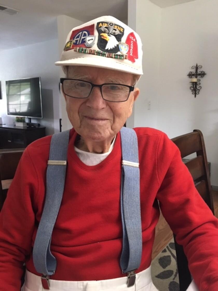 Joseph Stolmeier wearing his veteran's baseball cap displaying his World War II medallions.<br>