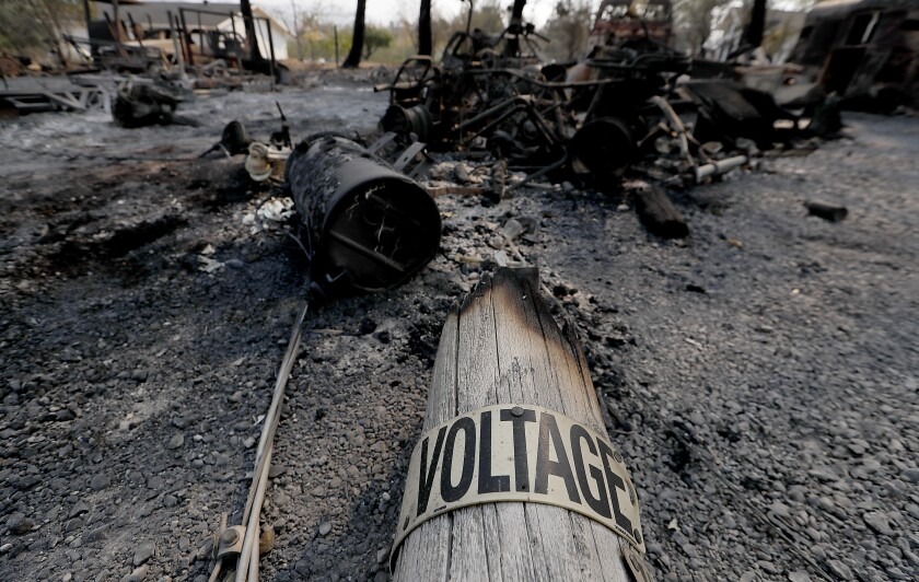 HEALDSBURG, CALIF. - OCT. 28, 2019. A charred utility pole lies amid burned machinery along Chalk Hill Road near Healdsburg on Tuesday, Oct. 29, 2019. (Luis Sinco/Los Angeles Times)