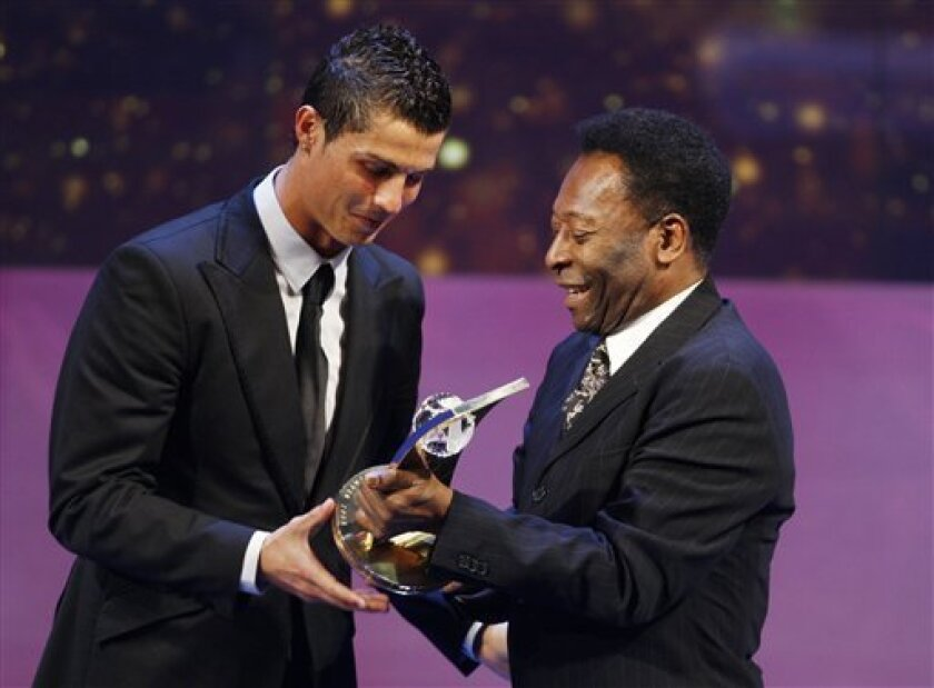 Soccer player Cristiano Ronaldo from Portugal, left, receives the trophy from former Brazilian soccer star Pele, right, after being named FIFA World Player of the Year during the FIFA World Player Gala 2008 at the Opera house in Zurich, Switzerland, Monday, Jan.12, 2009. (AP Photo/KEYSTONE/Steffen