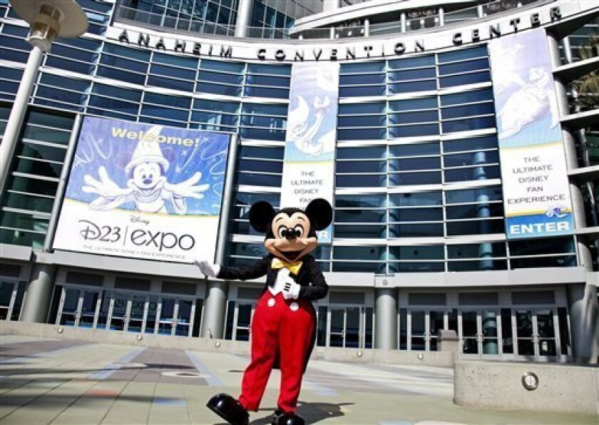 FILE - In this Sept. 9, 2009 handout photo released by Disney, Mickey Mouse stands in front of the Anaheim Convention Center in preparation for the Disney D23 Expo in Anaheim, Calif. The Walt Disney Co. is cracking open the vault, rolling out the red carpet and pulling back the curtain for more than 45,000 expected fans at this weekend's D23 Expo, Aug. 9-11, 2013, a three-event celebration of all things Disney at the Anaheim Convention Center. On the animation front, the studio will showcase W