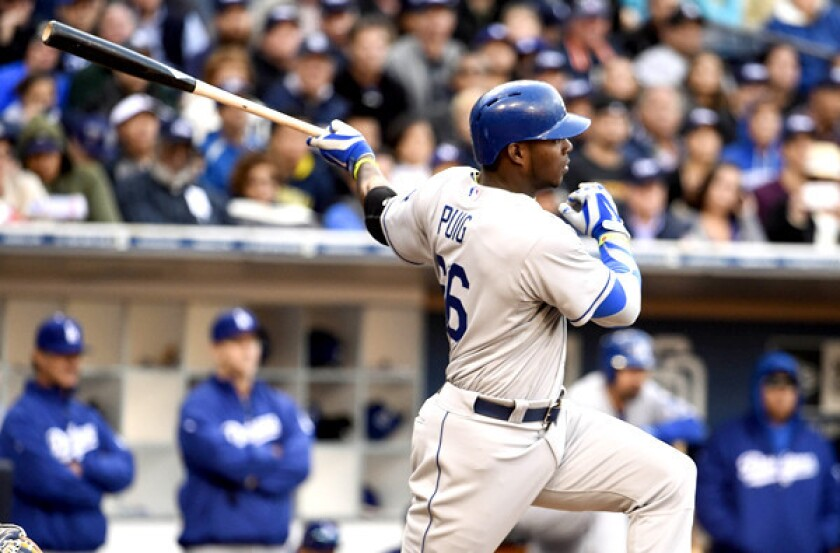 Dodgers right fielder Yasiel Puig follows through on a single against the Padres on Tuesday night in San Diego.