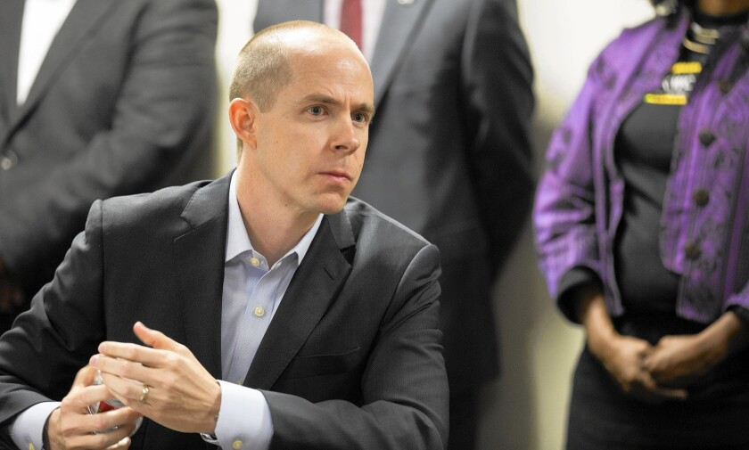 Rusty Hicks, head of the Los Angeles County Federation of Labor, has argued for an exemption for union members from the city's new minimum-wage law.