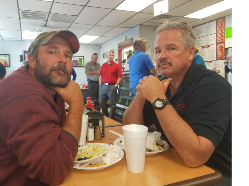Shawn Lewis, left, and his boss, Tommy Morrison at Pete's Grill in Stanley, N.C.