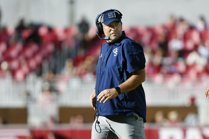 Georgia Southern coach Chad Lunsford watches his team during the second half of an NCAA college football game Saturday, Sept. 18, 2021, in Fayetteville, Ark. (AP Photo/Michael Woods)