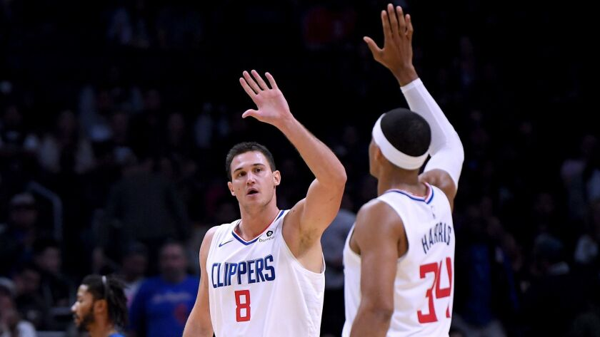 Danilo Gallinari (8) and Tobias Harris (34) of the Clippers celebrate a lead over the Minnesota Timberwolves on their way to a 120-109 win at Staples Center on Nov. 5, 2018.