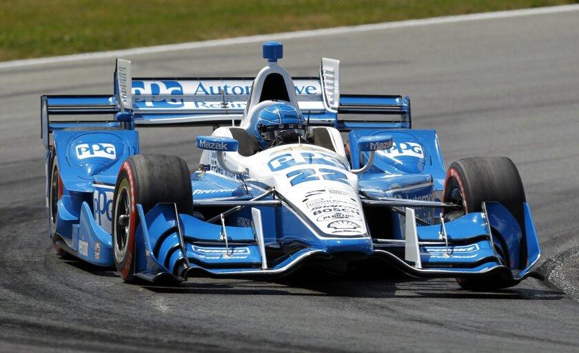 Simon Pagenaud, of France. drives during the IndyCar Honda Indy 200 auto race Sunday, July 31, 2016, at Mid-Ohio Sports Car Course in Lexington, Ohio. Pagenaud won the race. (AP Photo/Tom E. Puskar)