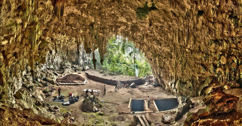 This 2012 photo provided by the Smithsonian Institution and the Liang Bua Team shows Liang Bua, a limestone cave on the Indonesian island of Flores, as the Liang Bua Team prepares for new archaeological excavations. In 2004, researchers reported that evolutionary cousins of modern humans, nicknamed hobbits, lived until fairly recently in the cave. Now a new study indicates they died out much earlier than originally believed. (Smithsonian Digitization Program Office and Liang Bua Team via AP) MANDATORY CREDIT