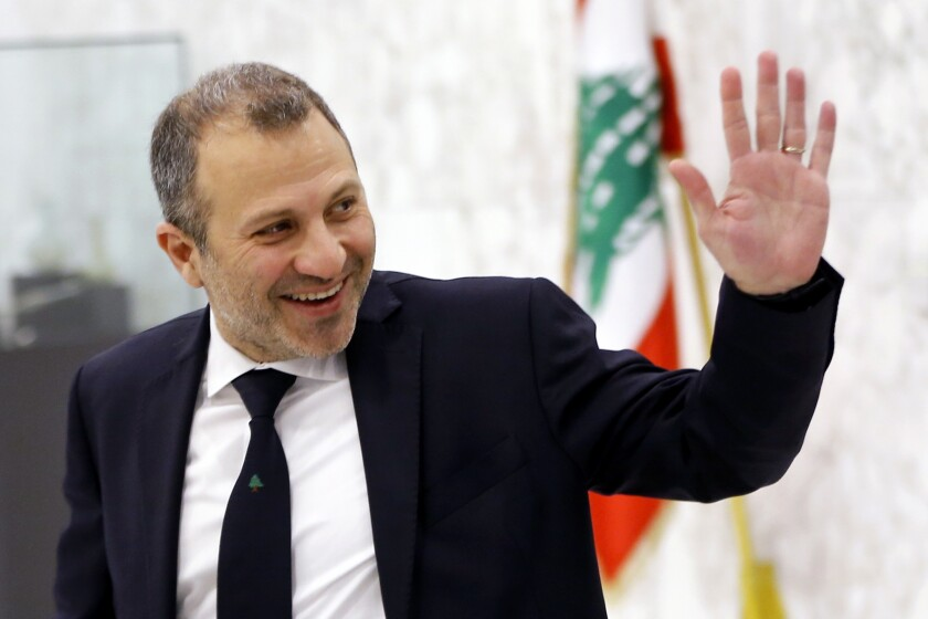 FILE - This Feb. 2, 2019 file photo, then Lebanese Foreign Minister Gebran Bassil arrives to attend a meeting of the Lebanese cabinet at the Presidential Palace in Baabda, east of Beirut, Lebanon. A former Lebanese foreign minister and son-in-law of President Michel Aoun has tested positive for the new coronavirus, his office said Sunday, Sept. 27, 2020. (AP Photo/Bilal Hussein, File)