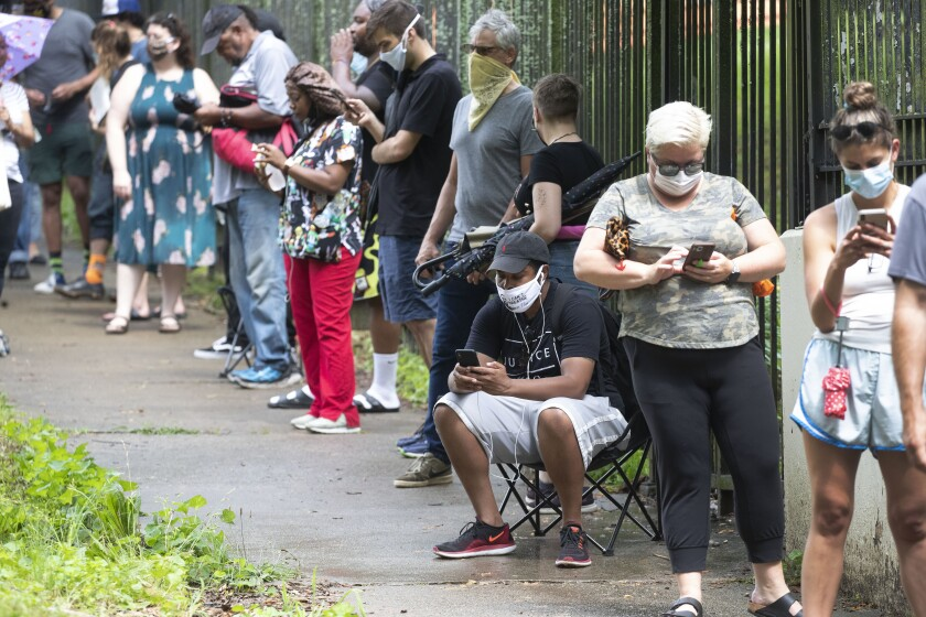 Voters wait in a long line to cast their ballots at an Atlanta polling site on Tuesday.