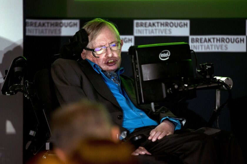 """Renowned physicist Stephen Hawking attends a press conference in London, Monday, July 20, 2015. Renowned physicist Stephen Hawking and Russian tech entrepreneur Yuri Milner are pushing the search for extraterrestrial life into higher gear. The pair said Monday the $100 million """"Breakthrough Initiatives"""" program funded by Milner will harness computer power as never before in a search of the heavens. (AP Photo/Matt Dunham)"""