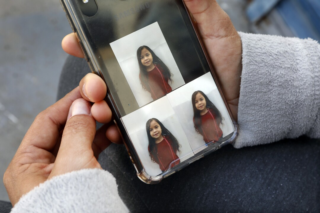 Pictures of a young girl on a phone.