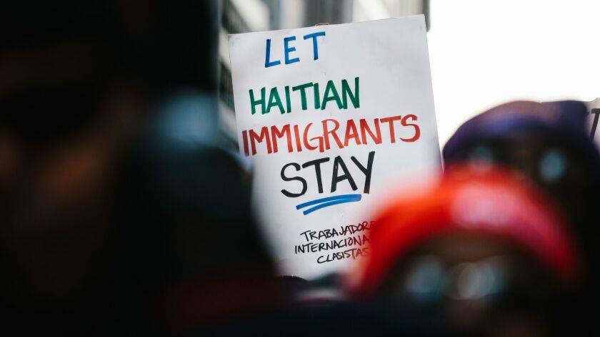 A protester holds a sign at a rally in New York on Jan 15.