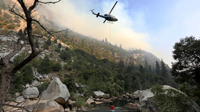 YOSEMITE, CALIF. -- MONDAY, AUGUST 13, 2018: Helicopter crews work to stamp out the Ferguson fire as