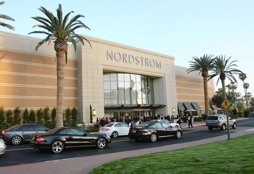 Cars line up for valet parking for a past gala at Nordstrom in Fashion Island. The department store will be one of many stores at the Newport Beach mall to offer curbside service starting Friday.
