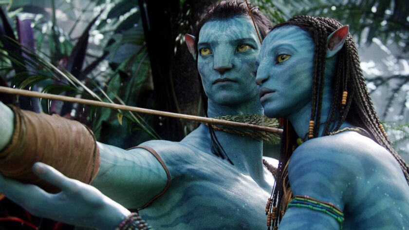 """FILE - This undated file film publicity image originally released by 20th Century Fox shows the characters Neytiri, voiced by Zoe Saldana, right, and Jake, voiced by Sam Worthington, in a scene from """"Avatar."""" Director James Cameron announced plans to shoot and produce the next three """"Avatar"""" sequel"""