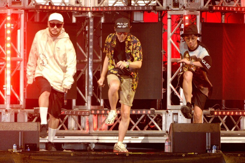 Members of Epik High perform onstage during Day 3 of the 2016 Coachella Valley Music and Arts Festival during the first weekend.