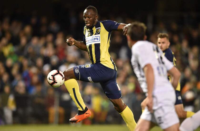 Olympic sprinter Usain Bolt (C), playing for A-League football club Central Coast Mariners, shoots on goal against Macarthur South West United in his first competitive start for the club in Sydney on October 12, 2018.