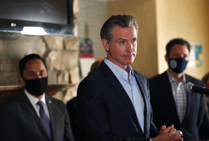 Gov. Gavin Newsom speaks at a news conference.