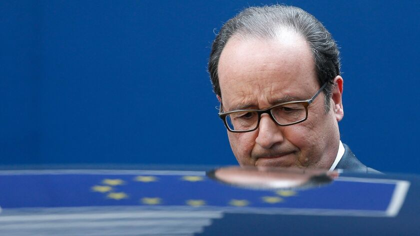 epa05935470 French President Francois Hollande leaves after the special european summit in Brussels,