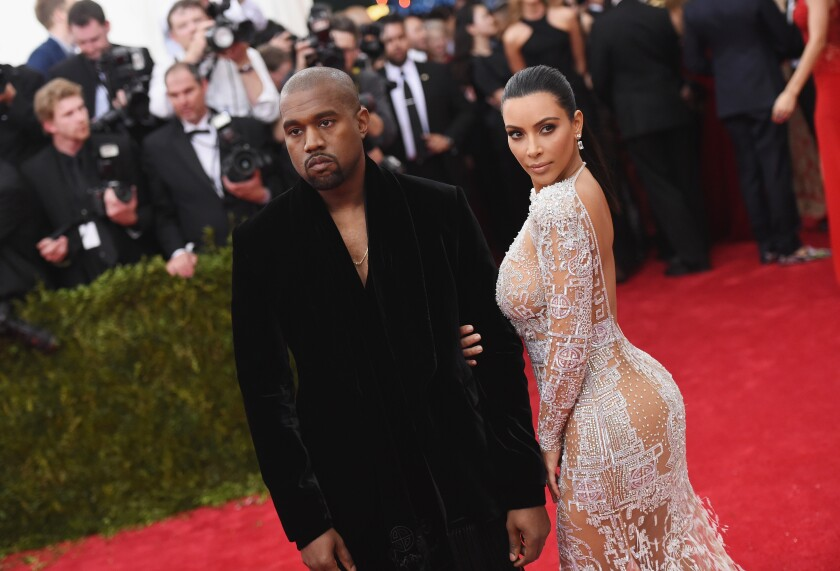 Kanye West and Kim Kardashian walk the Met Gala red carpet in 2015