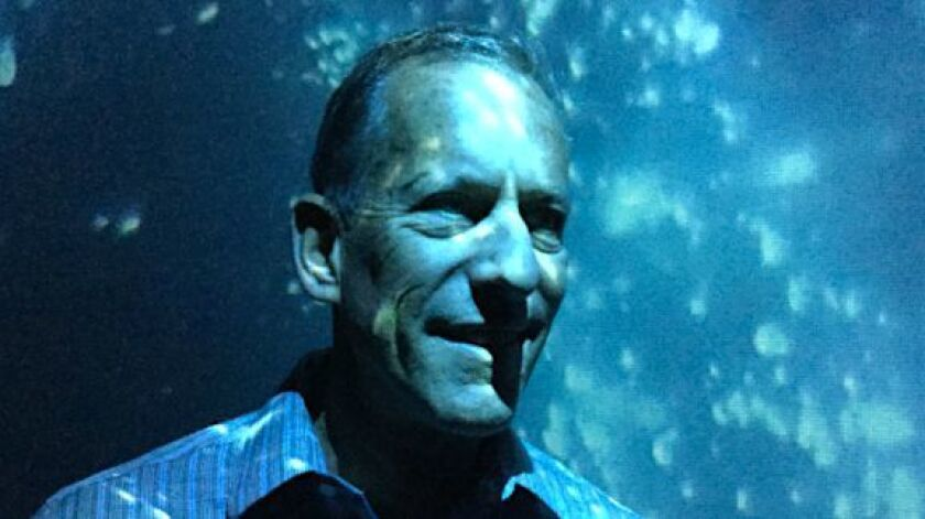 Scripps Institution of Oceanography researcher Michael Latz stands inside the Infinity Cube and look