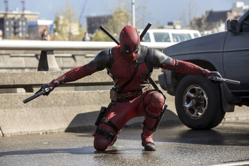 "Ryan Reynolds is the wise-cracking guy in red in the R-rated superhero movie ""Deadpool."""