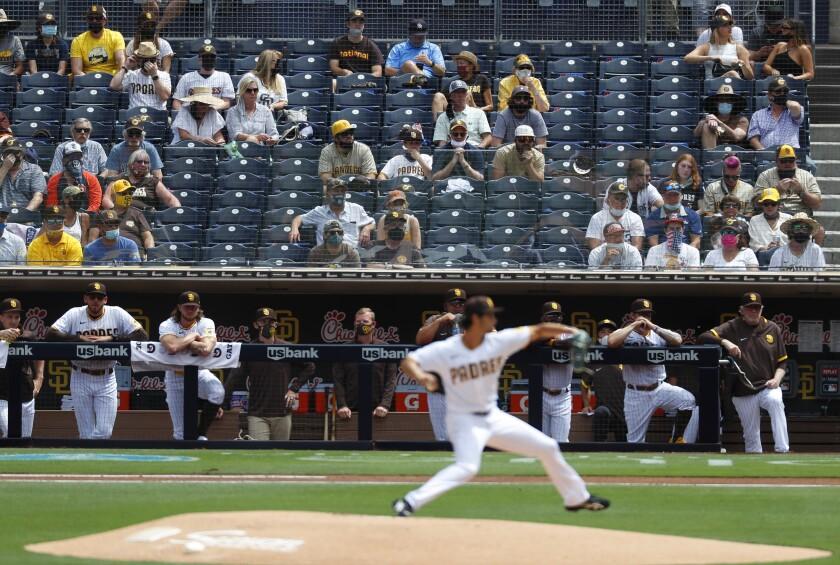Fans watch as San Diego Padres pitcher Yu Darvish throws against the Arizona Diamondbacks.