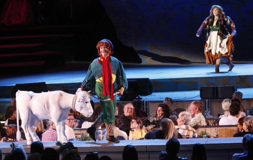"Gaten Matarazzo, onstage with a faux calf, is Jack in the Hollywood Bowl production of ""Into the Woods"" in July. In the background: Rebecca Spencer as Jack's mother."