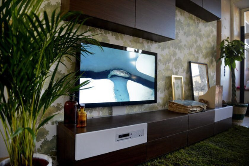 Ikea's new Uppleva system integrates an LED television as well as other electronics into a single piece of furniture.