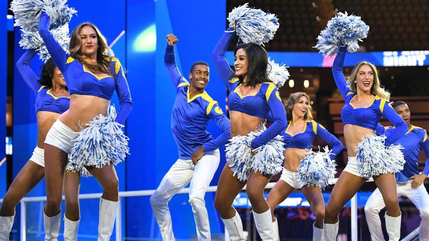 Rams cheerleader Quinton Peron performs during media day in Atlanta on Monday.