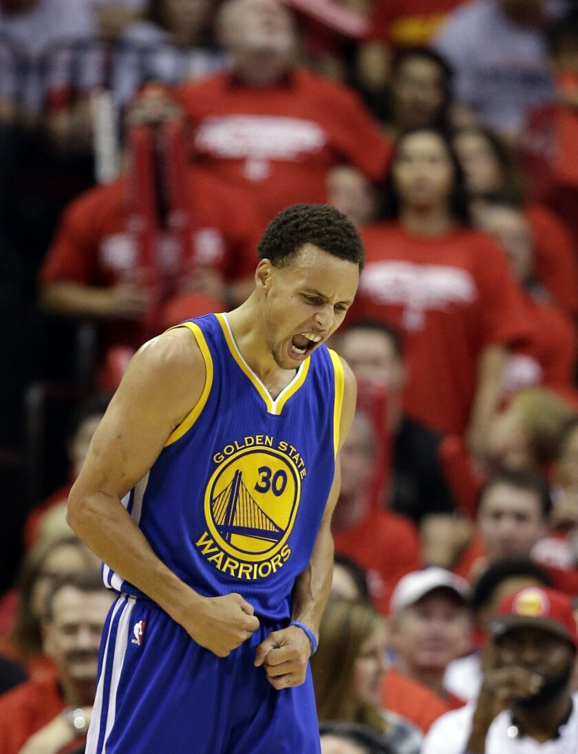 Golden State Warriors guard Stephen Curry (30) reacts after making a 3-point basket against the Houston Rockets during the second half in Game 3 of the NBA basketball Western Conference finals Saturday, May 23, 2015, in Houston. (AP Photo/David J. Phillip)