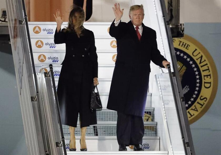 US President Donald Trump (R) and First Lady Melania Trump disembark from Air Force One at Orly airport, Paris, France, Nov. 9, 2018. EPA-EFE/Ian Langsdon