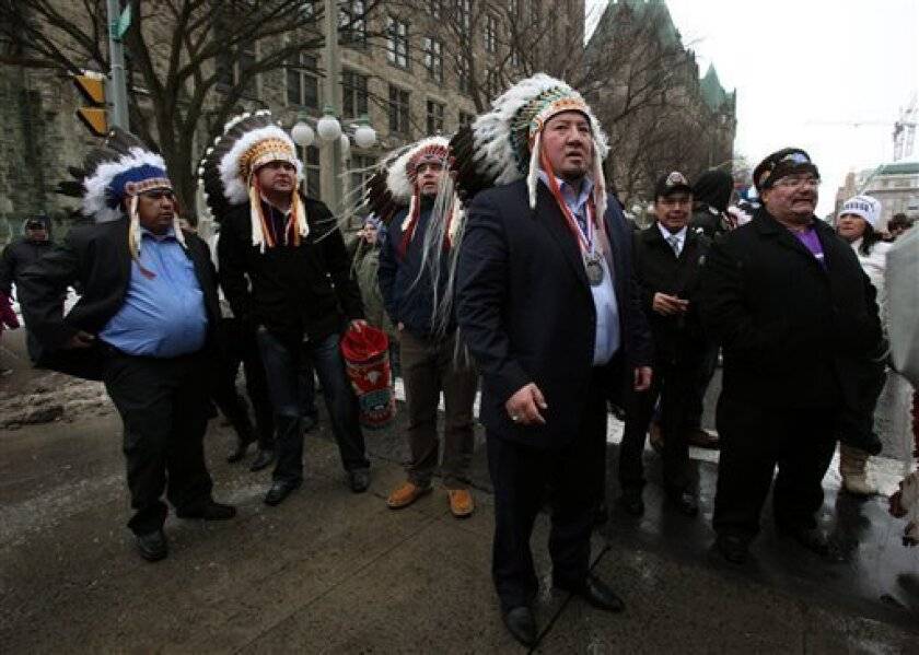 Grand Chief Derek Nepinak, front, of the Assembly of Manitoba Chiefs meets up with aboriginal protestors as they march from Victoria Island to Parliament Hill in Ottawa on Friday, Jan. 11, 2013. The highly politicized meeting between Prime Minister Steven Harper and First Nations leaders is underway, taking place in the prime minister's Langevin Block office despite pleas that it be moved. About 20 First Nations leaders attended the meeting, representing most areas of the country, even after a tumultuous night of talks that saw chief after chief reject the meeting because it was not on their turf or on their terms. (AP Photo/The Canadian Press, Patrick Doyle)