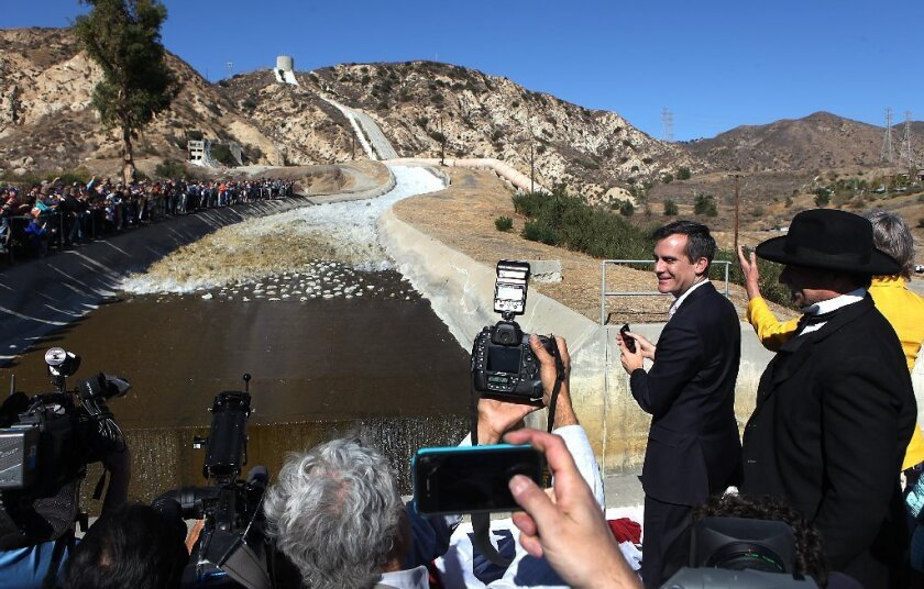 Mayor Eric Garcetti is seen applauding as water flows down the 100-year-old Los Angeles Aqueduct Cascades during celebrations last November marking the 100th anniversary of the aqueduct's opening.