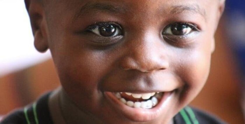 This is a recent photo of Daniel, a Haitian boy, who was found abandoned in August 2013 on a trash heap in Haiti, where pigs were feeding in the still-messy aftermath of the 2010 Haitian earthquake. He is now a healthy and happy toddler.