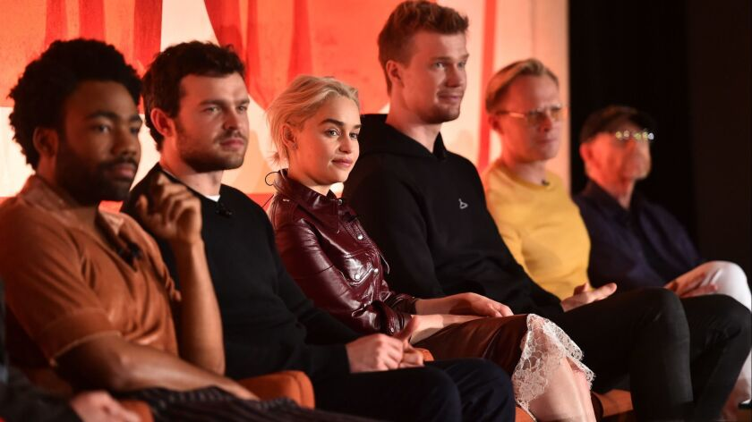 "Actors Donald Glover, left, Alden Ehrenreich, Emilia Clarke, Joonas Suotamo, Paul Bettany and director Ron Howard at the ""Solo: A Star Wars Story"" news conference."