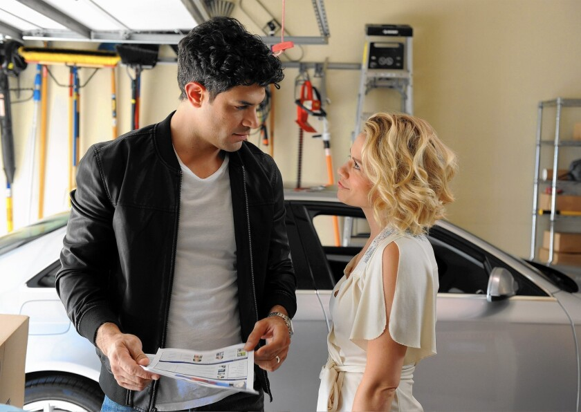 """Bethany Joy Lenz, here with Damon Dayoub, was pushed out of her role as Zoe on Shonda Rhimes' """"The Catch."""""""