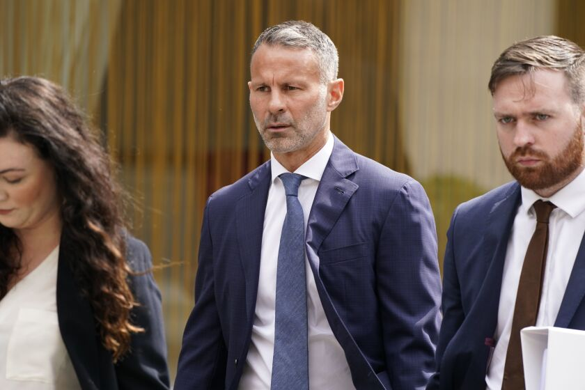 Former Manchester United soccer player Ryan Giggs, centre, arrives at Manchester Crown Court where he is charged with assaulting two women and controlling or coercive behaviour, in Manchester, England, Friday July 23, 2021. (Peter Byrne/PA via AP)